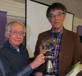 Rob Mason of Lichfield Movie Makers handing over the League trophy to Gordon Hunt.